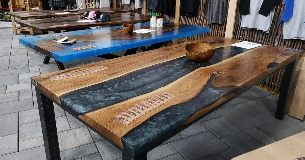 Several river tables in epoxy resin, photo taken during an exhibition